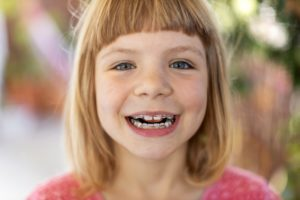 Young girl with pediatric braces in Milton smiles