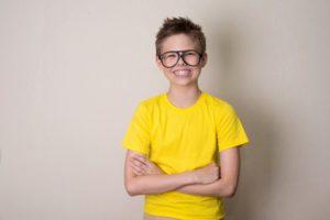 Smiling boy with braces or pediatric orthodontics in Milton